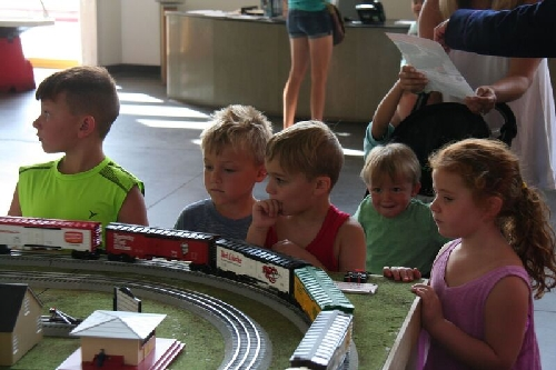 Children watch as the model train layout comes to life at the Long Island Childrens Museum with Lionel Club Ambassador Nassau Lionel Operating Engineers