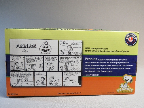 On the side of the box of the Lionels Peanuts Halloween LionChief Remote Train Set 6-30214 there are cartoon strips as pointed out in the product review by The TTOS  Silver State Division Lionel Club Ambassador