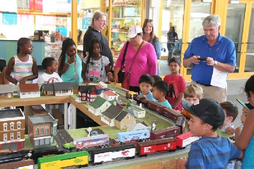 Lionel Club Ambassador Nassau Lionel Operating Engineers at the Long Island Childrens Museum display their model train layout and children gather to watch