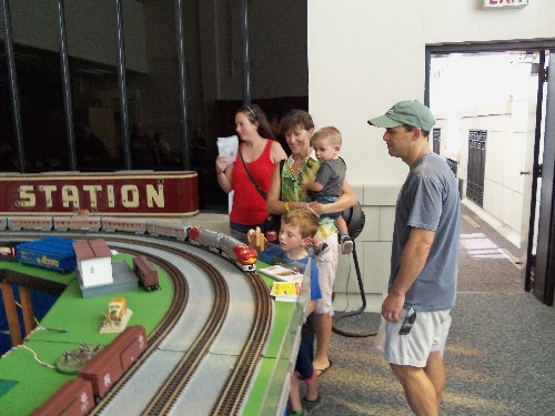 Image with boy and family reacting to movement on the layout at the Wichita Toy Train ClubClub Ambassadors to Lionel July 2016 in Wichita KS