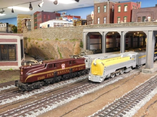 View of locomotives going through the tunnel on the layout October 2016 Open House held by the NLOE Lionel Club Ambassador