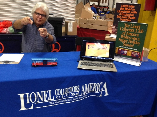 The sign up table at an event has a Lionel Collectors Club of America member greeting with enthusiasm