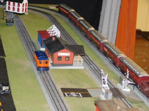 The modular layout set up by the Nassau Lionel Operating Engineers Lionel Club Ambassador ran the Lionel Lines Trolley Car