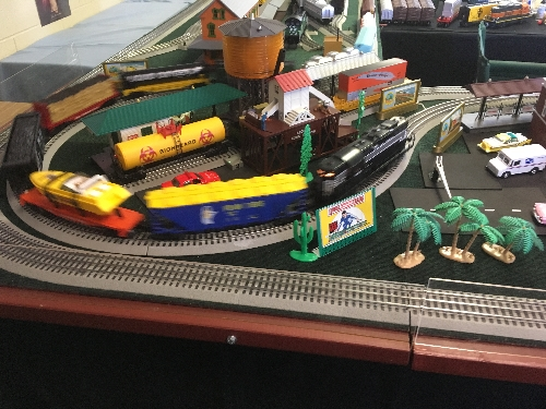 Various types of rolling stock or train cars rumble on the The TTOS Southern Pacific Division Lionel Club Ambassador layout at the St Adelaide Church Festival