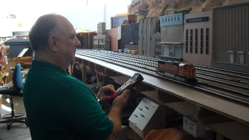 Club Member Randy throttling up his engine on the TMB Model Train Club Lionel Club Ambassador model train layout
