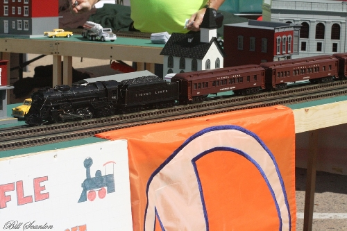 At the Bellmore Street fair showing Lionel Lines Passenger Train Set on the modular layout displayed by Lionel Club Ambassador TMB Model Train Club