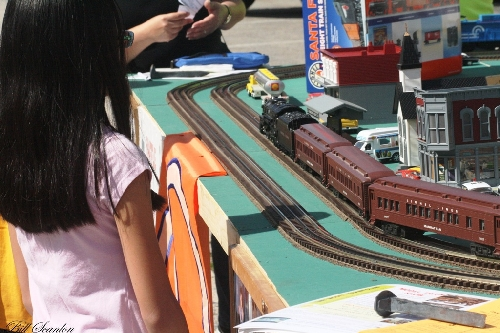 Displayed by Lionel Club Ambassador TMB Model Train Club at the Bellmore Street fair the Lionel Lines Passenger Train Set on the modular layout as families watched the train go by