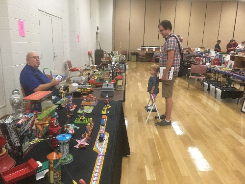 Even the youngest fan enthusiastically viewed the displays at the November 2016 Train Meet held by the TTOS  SPD a Lionel Club Ambassador