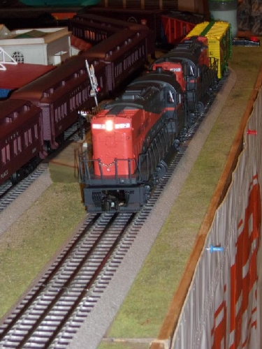 The locomotive is coming straight down the rails in Bellmore New York at the September 2016 Event where the NLOE Lionel Club Ambassador runs their model train layout