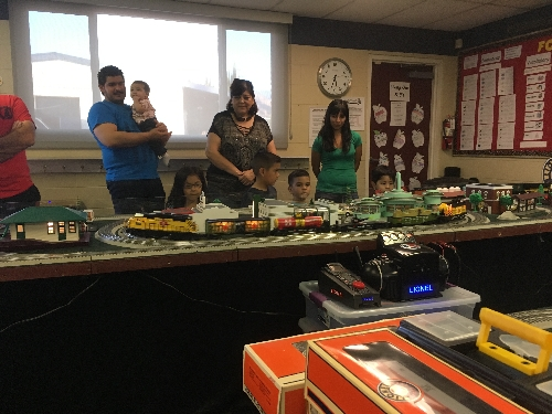 Families share in the excitement of the The TTOS Southern Pacific Division Lionel Club Ambassador layout at the St Adelaide Church Festival