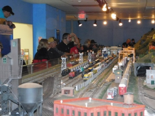 The Nassau Lionel Operating Engineers Lionel Club Ambassador had everyones attention as they operated trains and accessories on the elaborate layout at the October 2016 Open House