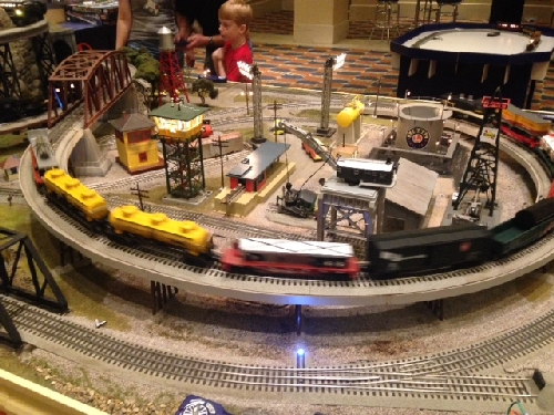 Families stop to see all the excitement on the layout at The 45th Annual Lionel Collectors Club of American Convention