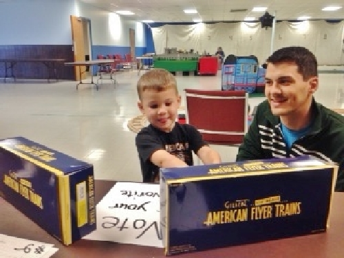 Boys ages 3 to 12 came to vote on the American Flyer Scale Cylindrical Hoppers shown in the Lionel Club Ambassador Wichita Toy Train Club product review