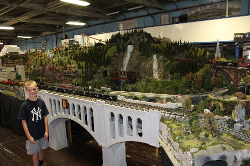 The NJ HiRailers Model Railroad Club  Lionel Club Ambassadors Brandon vistiting his grandfather takes a look at the layout
