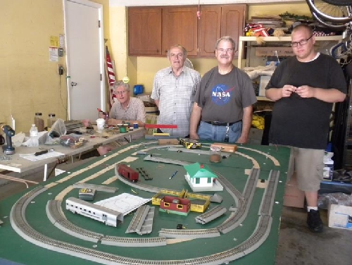 Chicagoland Association of S Gaugers Lionel Ambassador Club Crew work to revamp the portable layout to include American Flyer FasTrack