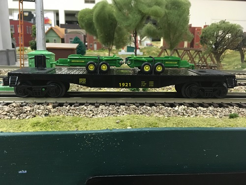 From the review by Lionel Club Ambassador The Wichita Toy Train Club the John Deere Flatcar with 2 John Deere spreaders 6-83238 is shown in side view