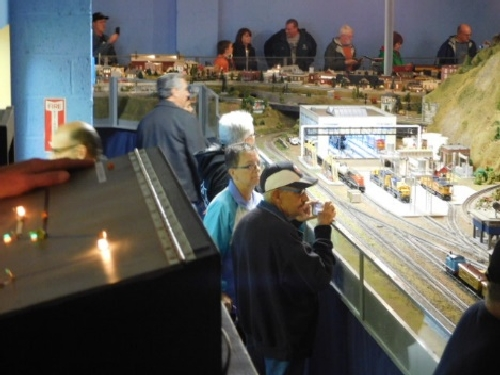People gather around the model train layout at the October 2016 Open House held by the NLOE Lionel Club Ambassador