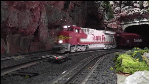 Santa Fe Warbonnet LEGACY Scale ES44AC Diesel 440 6-82215 pulling train cars on layout in the Lionel Club Ambassador New Jersey Hi Railers Video Review  CLUB AMBASSADORS TO LIONEL Image