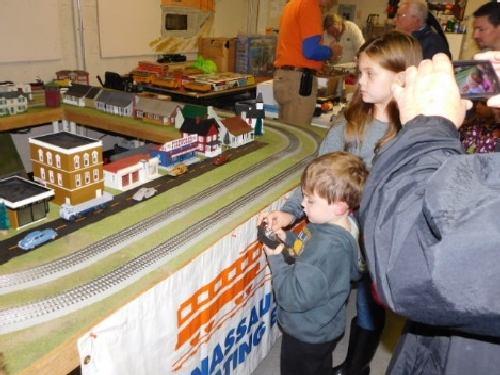 At the October 2016 Open House hosted by the NLOE Lionel Club Ambassador kids use the remote to operate trains