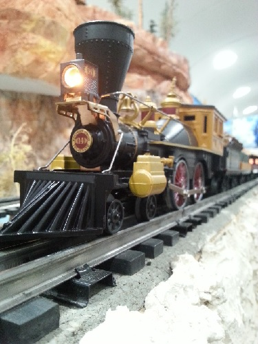In the TTOS-SSD Club Ambassadors to Lionel  product review the Western Union Telegraph locomotive from 6-81264 train set is pulling the trains cars down the tracks