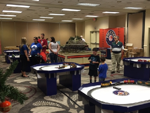 Kids play with a number of Lionels model train layouts in Kansas City MO at the Lionel Collectors Club of America 46th Annual Convention