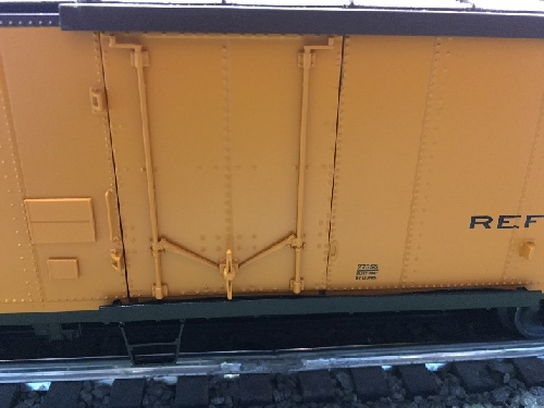 Showing New York Central Steel-sided Refrigerator Car 6-27355 plug door in the Nassau Lionel Operating Engineers Lionel Club Ambassadors product review