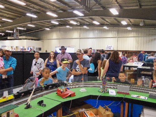 The Wichita Toy Train Club Lionel Club Ambassador had crowds gathered to view the trains running on layout set up at the 2016 Kansas State Fair