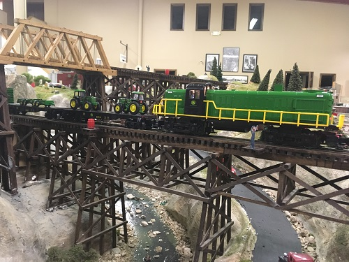 The John Deere Flatcar w2 spreaders and Ready-to-Run Train set looks great on the Lionel Club Ambassador WTTC layout