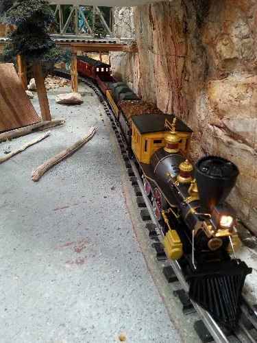 A view of The Western Union Telegraph locomotive and complete trains set 6-81264 through the layout in the product review by The TTOS  SSD Lionel Club Ambassador