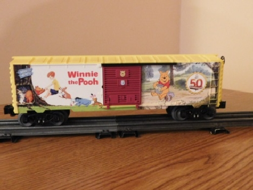 View of the art on the side of the Winnie the Pooh 50th Anniversary Boxcar 6-82913 in the product review by the Nassau Lionel Operating Engineers a Lionel Club Ambassador