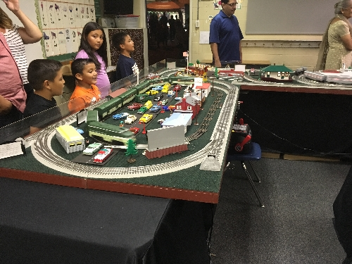 Lots of family fun around the TTOS Southern Pacific Division Lionel Club Ambassador layout at the St Adelaide Church Festival in Highland CA