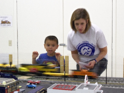 At the WTTC Open House Club Ambassadors to Lionel the first weekend of August 2016 a bBoy tells his mom to look at the train going at top speed