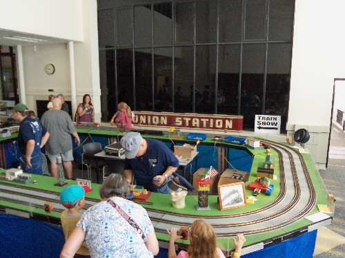Image of families enjoying the layout accessories at the Wichita Toy Train ClubClub Ambassadors to Lionel July 2016 in Wichita KS