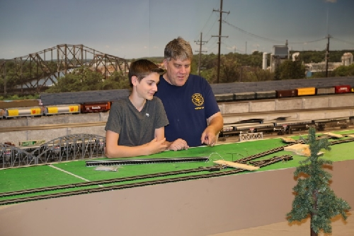 Boy Scouts attend the Chicagoland Lionel Railroad Club Lionel Club Ambassador Open House July 9 2016 to veiw the progress on the new layout