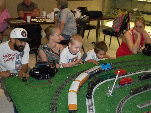 At the WTTC Open House Club Ambassadors to Lionel the first weekend of August 2016 kids look on for Thomas the Train run down the track