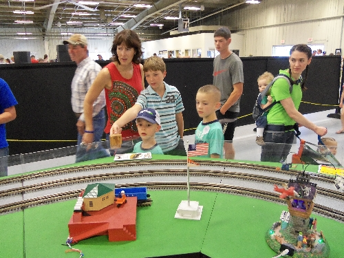 Children gathered to view the trains and accessories on the layout set up by the WTTC Lionel Club Ambassador at the Annual Kansas State Fair