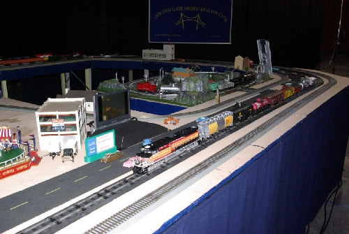 The Golden Gate American Flyer Club Lionel Club Ambassador runs model trains on  their modular layout at TTOS National Convention