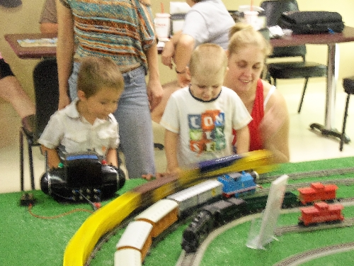 Kids look on for Thomas the Train when another train takes the outer loop at top speed during the WTTC Open House Club Ambassadors to Lionel the first weekend of August 2016