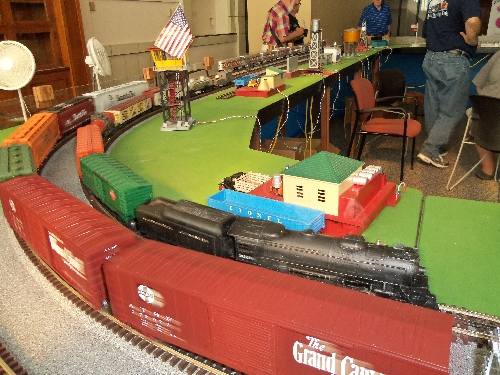 Omage of Train Cars around the bend on the layout at the Wichita Toy Train ClubClub Ambassadors to Lionel July 2016 in Wichita KS