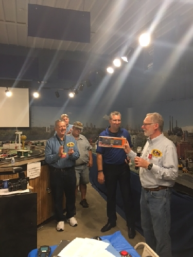 Herb Koch president of the Chicagoland Lionel Railroad Club received a one-of-a-kind Made in the USA boxcar from Lionel President Howard Hitchcock