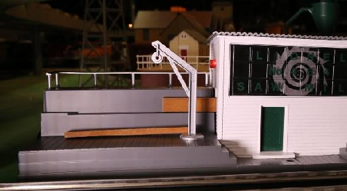 The CLRC Lionel Club Ambassador shows the blinking light when the cut board comes out in the review of the operating Sawmill with Sound